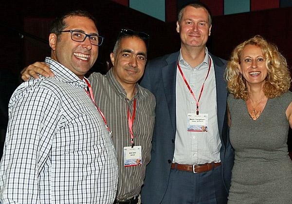 """מימין: קרין ולייקו, סמנכ""""לית השיווק והמכירות של NetCloud; מרטין פרגאמן, מנהל הערוצים ב-EMEA באורקל-NetSuite; אמיר עומרי, מנכ""""ל משותף ב-NetCloud, וג'ייסון אשר, מנהל חטיבת ה-eCommerce של אורקל-NetSuite. צילום: עזרא לוי"""